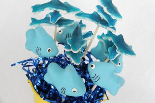 Shark cake pops. These creative Summer Cake Pops are perfect birthday or pool party desserts. From beach balls and sharks to lady bugs and crabs, enjoy these cute fun food ideas for cake pops!