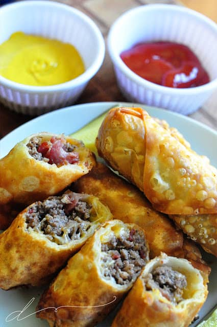 Easy dinner or appetizer eggroll recipe for mouthwatering Bacon Cheeseburger Egg Rolls! A cheeseburger wrapped up in a crispy egg roll shell.