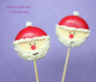 Christmas Santa Cheese Pops Christmas Olive Wreath - 25 Amazing Christmas Party Appetizer Recipes! Fun Food Ideas and more for a Holiday Party. LivingLocurto.com