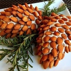 Pine Cone Cheeseball - 25 Amazing Christmas Party Appetizer Recipes! Fun Food Ideas and more for a Holiday Party. LivingLocurto.com