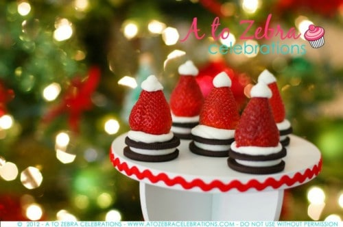 Easy Christmas Party Ideas. Love this Ornament Exchange Party and cute Santa Hat Strawberries! LivingLocurto.com