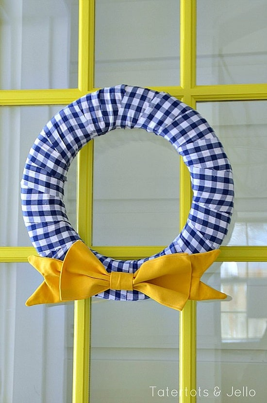 Simple navy and yellow fabric wreath by Tatertots & Jello.