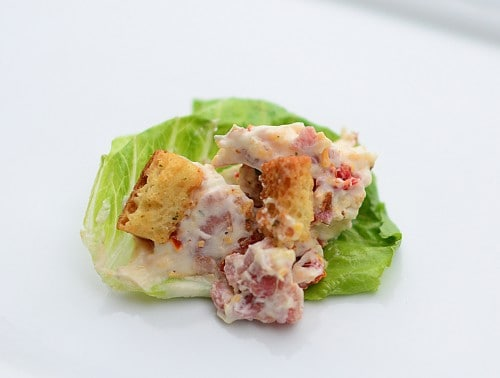 A quick and easy BLT, Bacon Lettuce and Tomato Dip Recipe. Scoop it on lettuce for a delicious low carb appetizer that's perfect for any party! LivingLocurto.com