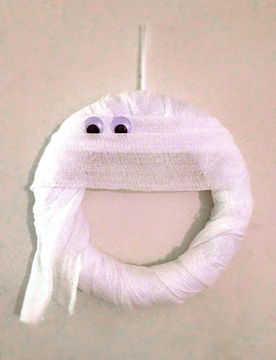 Heather from Glitter in the Air made a super fun and simple Mummy Wreath.
