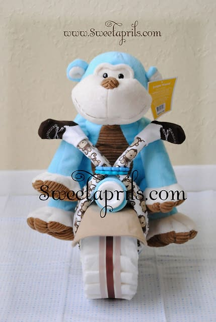 Monkey Motorcycle Diaper Cake Tutorial. 15 Creative Diaper Cakes. Amazing Baby Shower Party Ideas, crafts and homemade gifts.