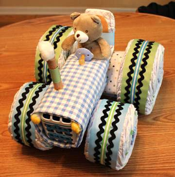 Tractor Diaper Cake Tutorial. 15 Creative Diaper Cakes. Amazing Baby Shower Party Ideas, crafts and homemade gifts.
