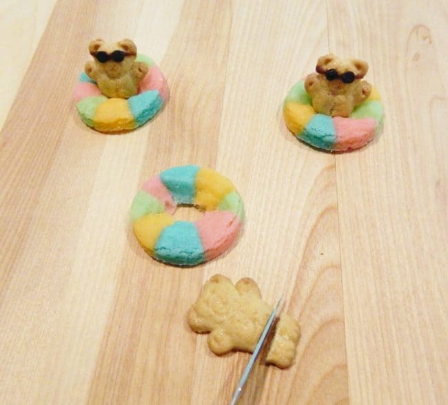 Rainbow Pool Float Cookies with Mini Teddy Grahams are cute edible life preservers perfect for a summer pool party ideas.