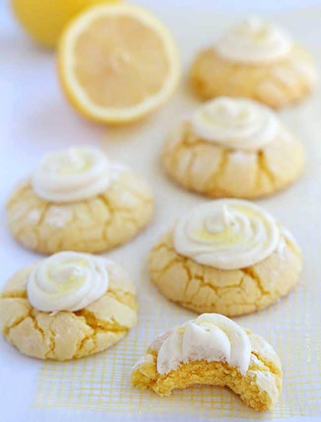 Easy lemon cookies recipe with homemade lemon frosting. Soft and fluffy lemon crinkle cake mix cookies!