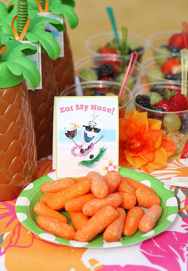 Frozen Summer Birthday Party Ideas! Cute printables. Disney's Olaf finally gets to enjoy the beach at a Luau. Fun food ideas, cupcakes, printables and games for the beach or a pool party. LivingLocurto.com
