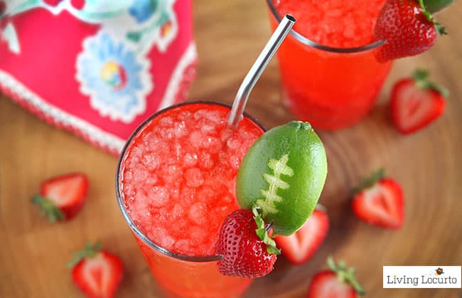 Strawberry Club Special is a fresh and fruity drink recipe to serve at your next party. A perfect game day drink with a lime football garnish! @livinglocurto