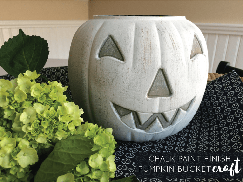 Easy Vintage Inspired Chalk Paint Pumpkin Planter - Upcycle those plastic pumpkin buckets with this fun DIY craft! Makes great fall planters, Thanksgiving or Halloween party centerpiece.