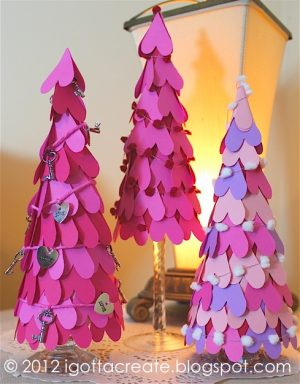 Paper Heart Trees - DIY Home Decoration Ideas for Valentine's Day. Easy to make Home Decor Crafts for Valentine's Day. Homemade Valentines ideas for mantle decorating, party tables, yard art, heart garland, valentine trees, kids rooms and more! LivingLocurto.com