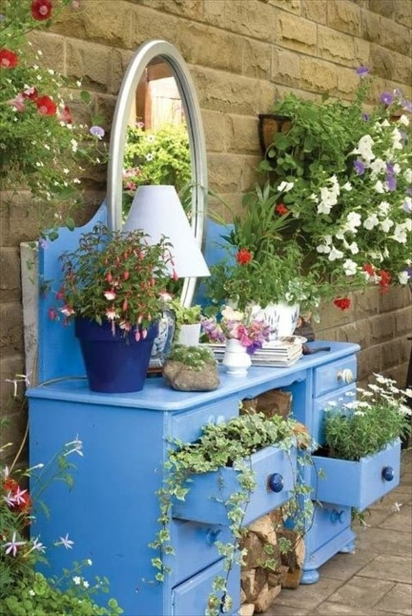 Dresser turned into a garden. Creative ways to add color and joy to a garden, porch, or yard with DIY Yard Art and Garden Ideas! Repurposed ideas for the backyard. Fun ideas for flower gardens made from logs, bikes, toys, tires and other old junk. ~ featured at LivingLocurto.com