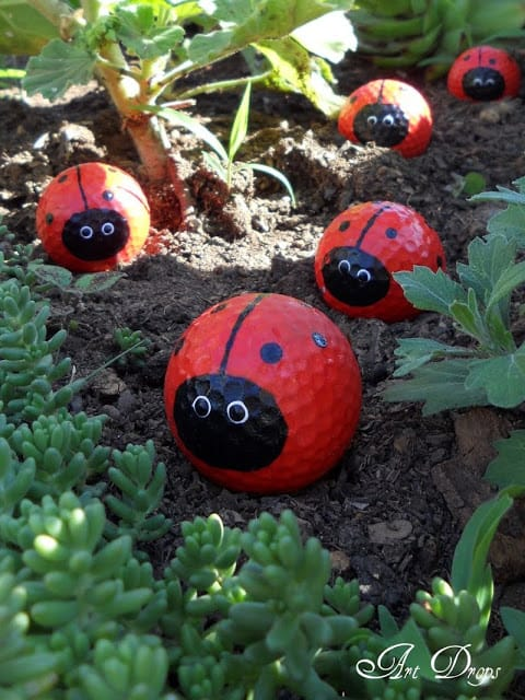 golf ball lady bugs! Creative ways to add color and joy to a garden, porch, or yard with DIY Yard Art and Garden Ideas! Repurposed ideas for the backyard. Fun ideas for flower gardens made from logs, bikes, toys, tires and other old junk. ~ LivingLocurto.com