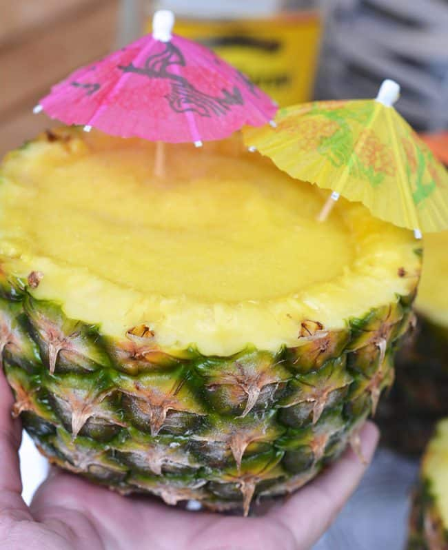 Pineapple Margaritas in a pineapple cup. The Best Margarita Recipes ever! From Strawberry and Blackberry to Pineapple and Coconut, you'll find a frozen cocktail perfect for party drink or a hot summer day! LivingLocurto.com