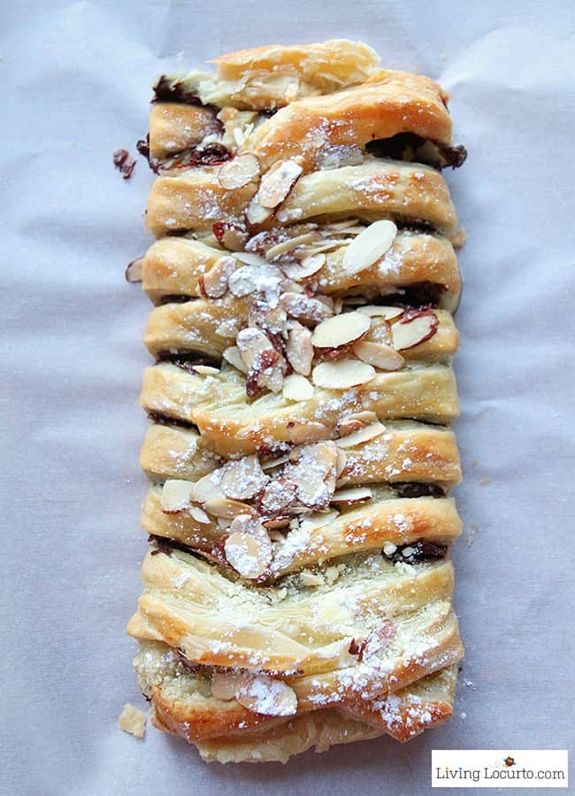 Chocolate Braid Recipe. Warm gooey chocolate baked inside of a tasty crescent puff pastry. Easy almond topped chocolate braid recipe for brunch, breakfast, or school party.