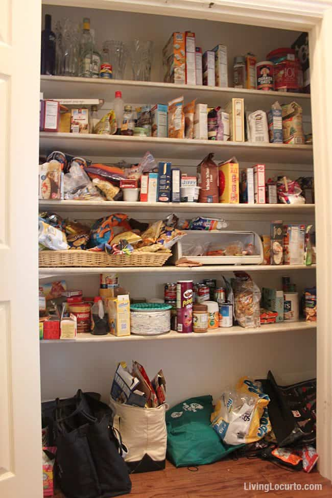 Before Kitchen Pantry Make Over Photo! Makeover your kitchen pantry with $50 or less! Inspiring kitchen pantry organization ideas with free printable chalkboard labels. Easy home organizing ideas. LivingLocurto.com