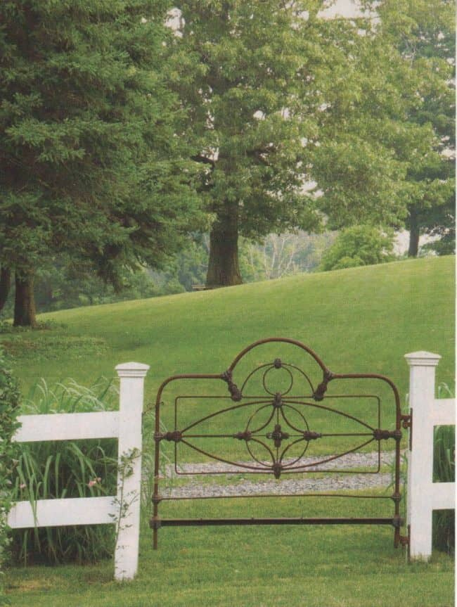 Old Iron Bed Post Gate. Beautiful backyard garden inspiration for your home! Creative gates for a gorgeous entryway into a yard or flower garden. Lovely tour of homes.