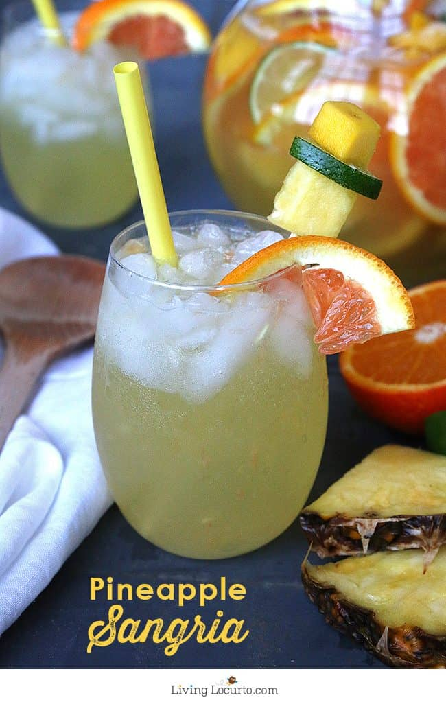 Tropical white sangria. A fruity Pineapple Sangria recipe. A perfect drink for a luau party or sipping by the pool. A cocktail that makes you feel like you're at the beach!