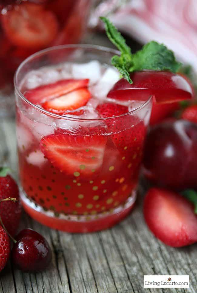 Strawberry Plum Rose Sangria. A refreshing pink wine party cocktail recipe! LivingLocurto.com