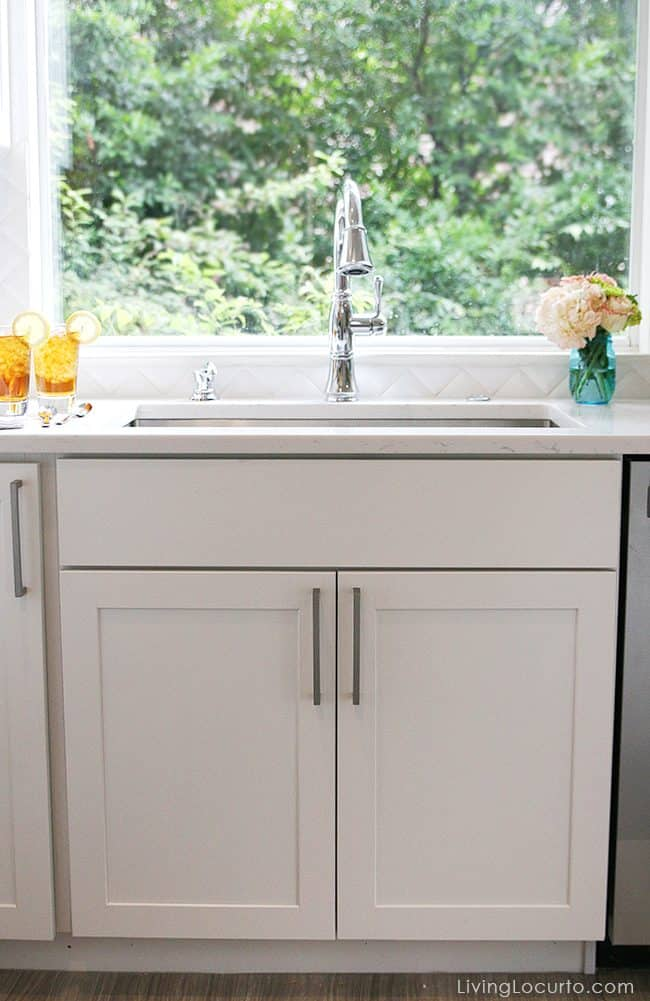 Before and after modern farmhouse white kitchen photos with an Elkay stainless steel sink and our favorite Wayfair kitchen products. Beautiful kitchen remodel!