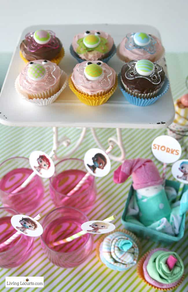 Easy Baby Shower Party Ideas and how to make adorable Baby Pacifier Cupcakes. Free printables and diaper cake inspiration. LivingLocurto.com