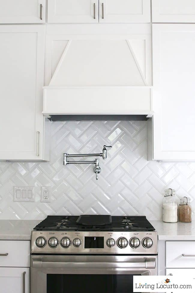 New White Kitchen Reveal. Amazing before and after photos of a modern farmhouse style kitchen home remodel. Home decorating and kitchen inspiration. Pot Filler and Kenmore Pro Range. LivingLocurto.com