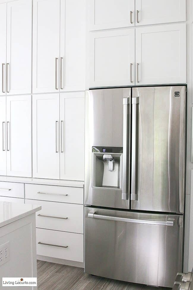 New White Kitchen Reveal. Amazing before and after photos of a modern farmhouse style kitchen home remodel. Home decorating and kitchen inspiration. Kenmore Pro Refrigerator. LivingLocurto.com