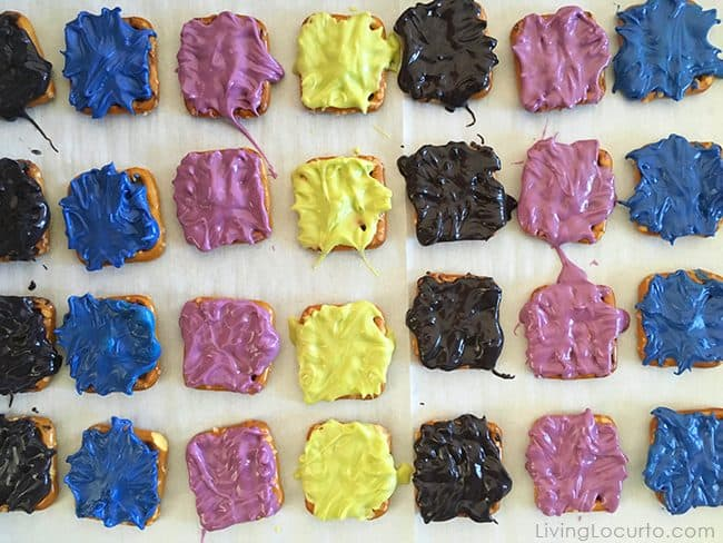 Monster Bites! Monster Candy Pretzels with FREE Printable Party Favors. No-bake chocolate covered pretzel treats for Halloween or a Monster birthday party.