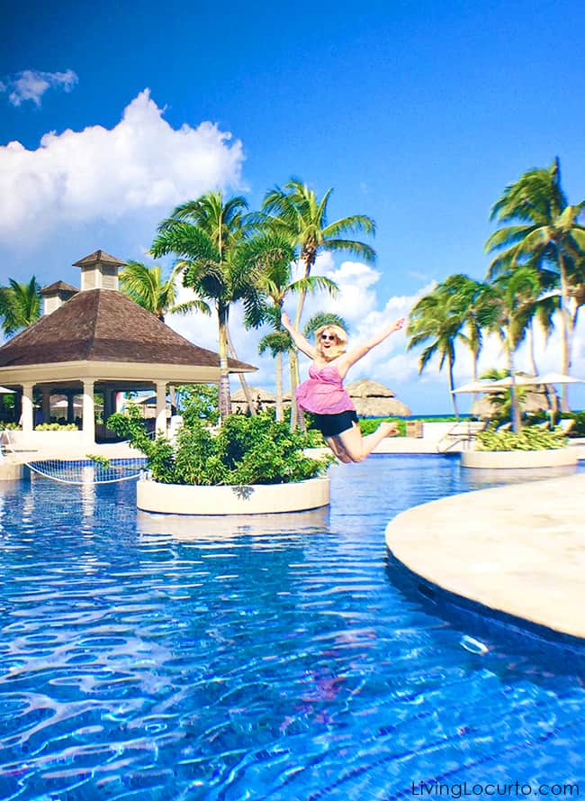 Jumping for joy! Amy Locurto travel and food blogger from Texas in Jamaica. Click retreat. Living Locurto blog.