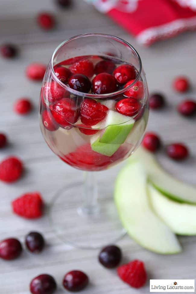 This easy Christmas Sangria recipe with cranberry, raspberry and white wine is an elegant cocktail drink for a Holiday party.