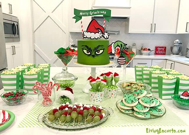 The Grinch makes an adorable Christmas party theme and this Merry Grinch-mas green Grinch cake will be the hit of your holiday celebration!