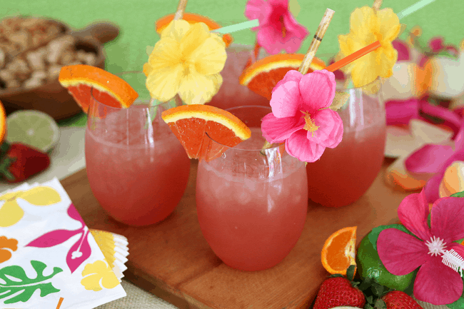 Luau Party Ideas! Tropical rum punch is a delicious summer cocktail recipe for a party or to sip by the pool!