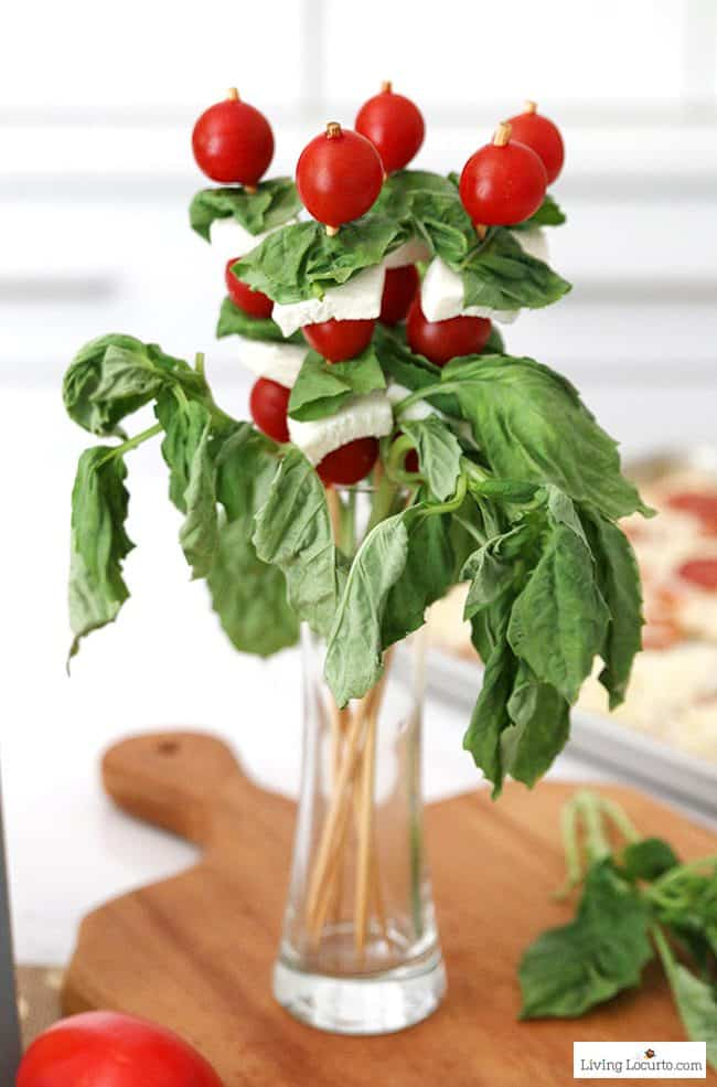 Easy Pizza Party Ideas! Tomato, mozzarella and basil skewers centerpiece. How to make a pizza bar with frozen pizza. Buffet idea for a family dinner, birthday party or graduation.