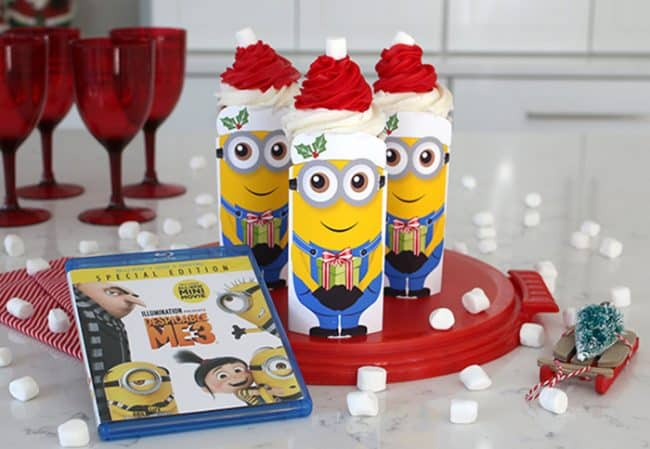 Minions Christmas cupcakes. A free printable, soda can and Santa hat cupcake. adorable Despicable Me 3 holiday party treats!