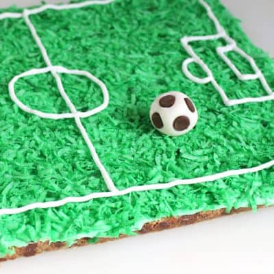 Early Man Soccer Cookie Cake