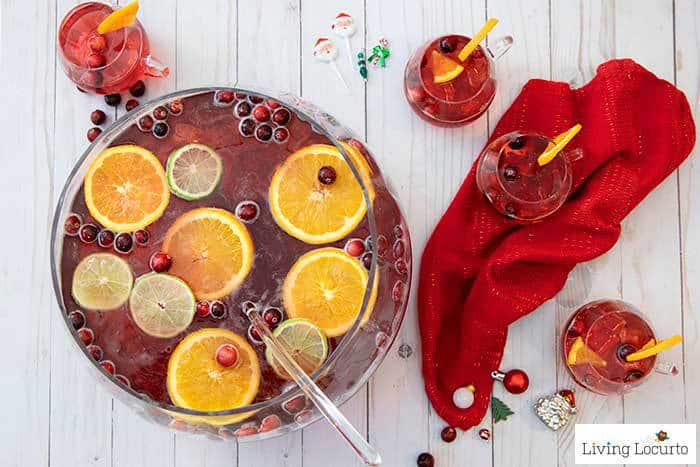 Holiday Punch Recipes are perfect for Christmas or a New Year's Eve Party! This EASY 5 ingredient cranberry ginger ale spiked punch is the best drink.
