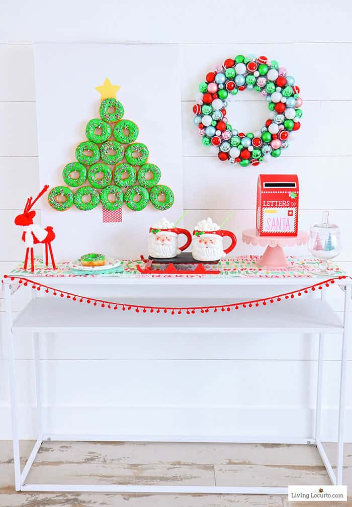 How to make a Christmas Tree Donut Wall. This simple Christmas party food craft will wow your guests! Cute dessert table idea, holiday decor and breakfast treat. LivingLocurto.com