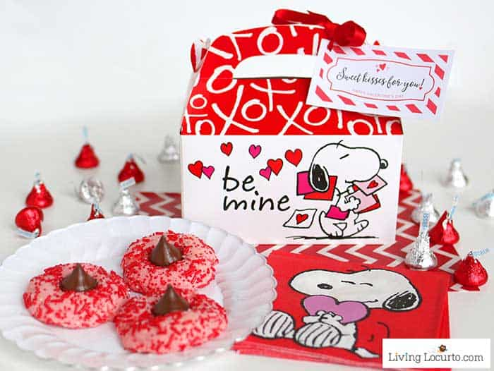 Valentine Strawberry Chocolate Kiss Cookies recipe! Strawberry cake mix thumbprint cookies rolled in red candy sprinkles and with a Hershey's Chocolate Kiss. LivingLocurto.com