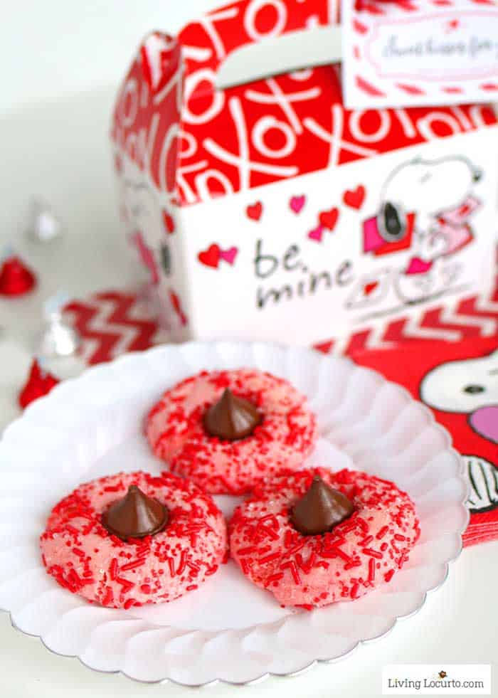 Easy Strawberry Chocolate Kiss Cookies recipe! Strawberry cake mix thumbprint cookies rolled in red candy sprinkles and with a Hershey's Chocolate Kiss. Cute Valentine's Day Cookies!