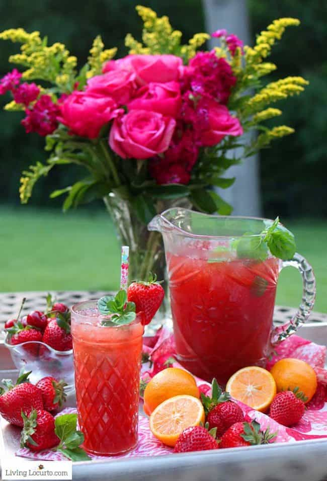 Strawberry Iced Tea recipe is an easy cocktail with fresh strawberries, mint, lemons and tea. LivingLocurto.com
