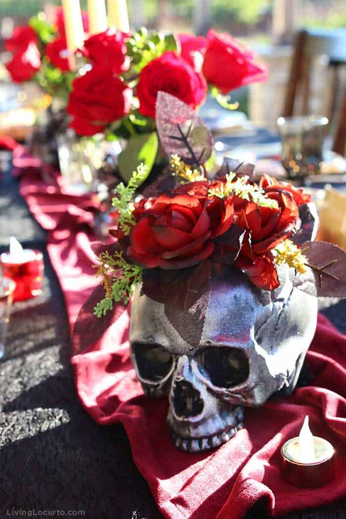 Skull Vase with Roses - Halloween Party Ideas for a Witch's Night Out! Inspiration for hosting an epic gothic Witch Halloween Party.